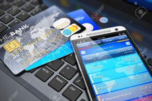 24471257-Mobile-banking-financial-success-accounting-and-electronic-internet-money-payments-business-concept--Stock-Photo
